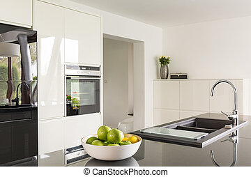 Futuristic high gloss kitchen in white with black worktop