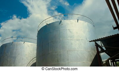 Industrial Water Tank. Blue Sky background