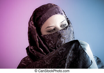 Arab veiled woman dressed lit with two lights, pink and blue