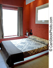 Hotel room - Modern hotel room with red walls and a bright...