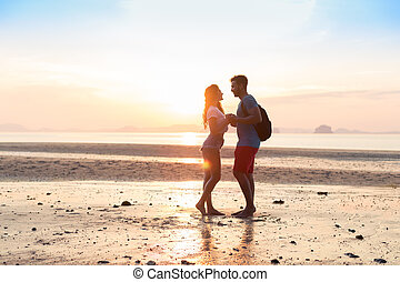 Couple On Beach At Sunset Summer Vacation, Beautiful Young People In Love, Man Woman Holding Hands