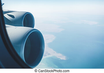 Airliner jet engines and coastal landscape, airplane in...