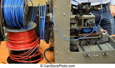 Printing with 3D equipment - 3D printer working and making a...