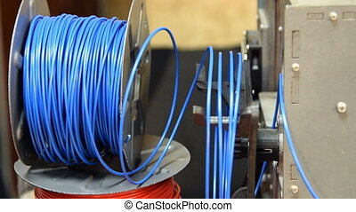 Spool of blue plastic for 3D printer - Close-up shot of a...