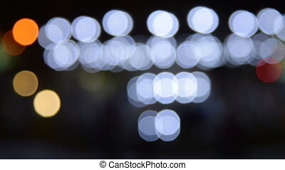 Blur of merry-go-round lights at night - Blurred lights of...