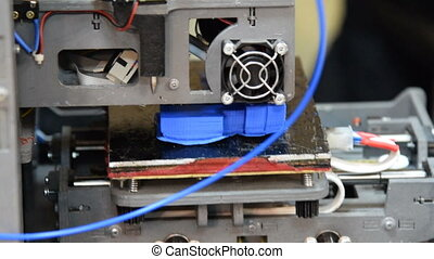 Working 3D printer - Close-up shot of 3D printer making an...