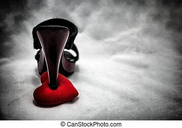 women shoes stomp on broken heart in dark tone., unrequited...