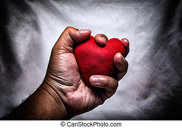 angry man crushing red heart in hand., unrequited love.,...