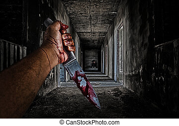 hand holding knife smeared with blood and some people...