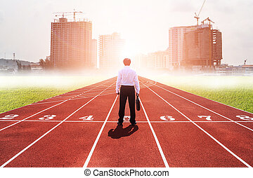 Business competition concept on track. Rear view of worker standing on the start line to city building. Motivation. Success. start up.