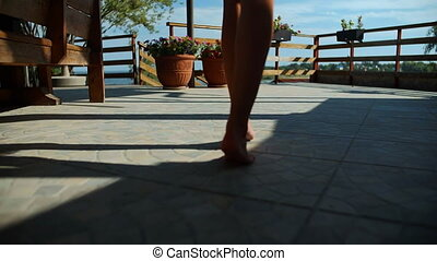 Beautiful Woman Bare Feet Walking on Concrete - Close up of...