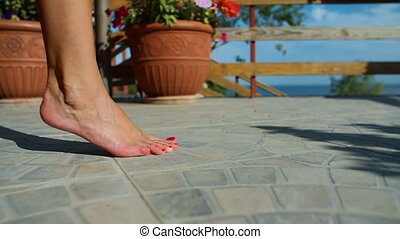 Close up of Woman Bare Feet on Concrete - Close up of woman...