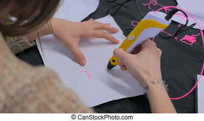 Woman using 3D printing pen - Close up shot. Woman using 3D...
