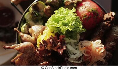 Tray with delicious grilled meat, fresh lettuce, pickled...