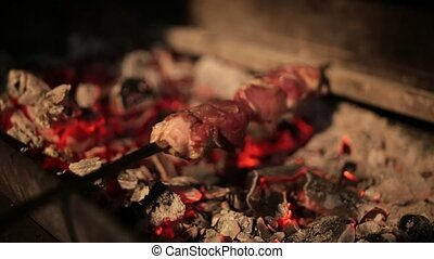 Appetizing skewers of meat fried on the coals in the brazier
