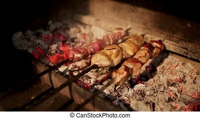 Process of cooking the shish kebab on coals on the grill -...