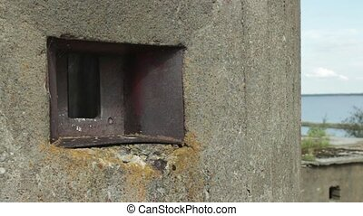 huge tower with loophole - rusty embrasure close to