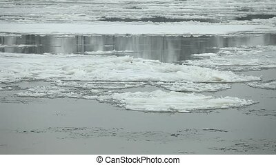 Floating of ice on the river - look floes floating on river...