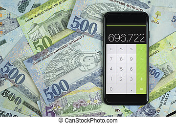 Saudi Riyal Currency with phone calculater - Phone...