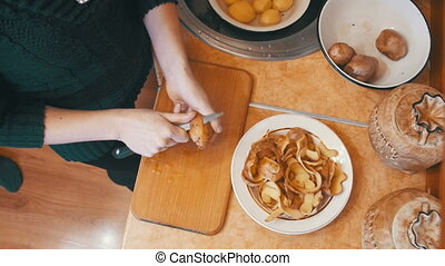 Cleaning Potatoes in the Home Kitchen - Peeling Potatoes in...