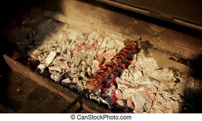 Lulah Kebab is fried on embers on the grill and it looks...