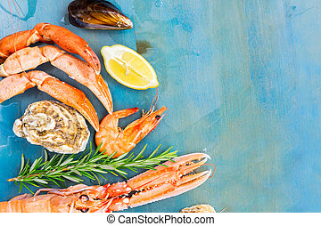 Fresh seafood on blue background - Fresh seafood set border...