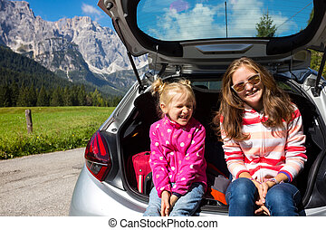 girls at the car trunk - young girls portrait at the car...