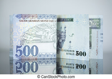 New Saudi Riyal notes vs Old one on a dark glass - Saudi...