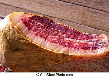 Iberian ham pata negra from Spain cut by hand on wood