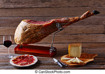 Iberian ham pata negra from Spain manchego cheese and red...