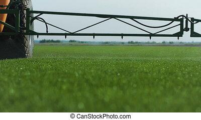 Farm Fetilizer Watering In The Green Lawn Field - Farm...