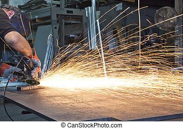metal grinding - sparks during metal grinding in a steel...