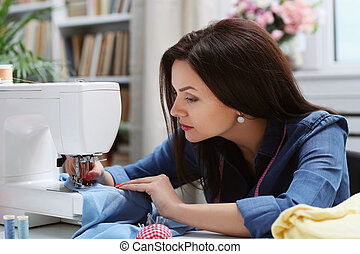 Seamstress - Lovely seamstress at the table