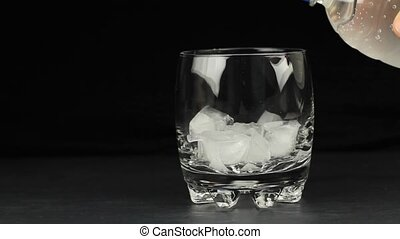 Mineral water in the glass with ice cubes 1080p HD Video