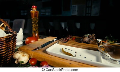 Barbecued Pork Ribs Set On Wooden Board With Garnish And...