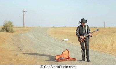 Guitarist on the desert road