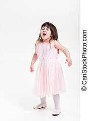 beautiful little girl in pink Princess dress naughty on a...