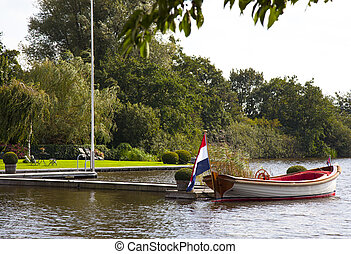 sloop at a dutch lake