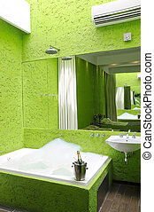 Green bathroom with jacuzzi - Interior of modern bathroom...