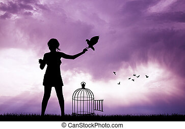 girl and bird cage at sunset