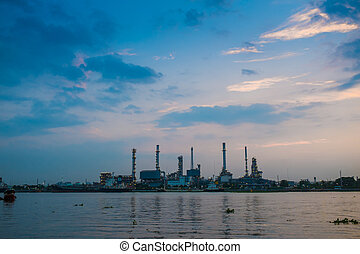 Oil refinery construction plant sunrise with river, Energy...