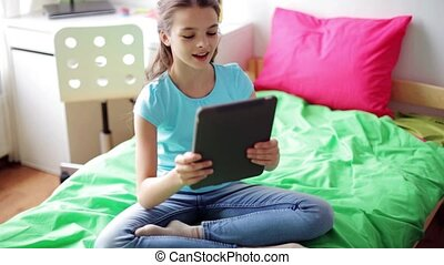 girl with tablet pc having video chat at home