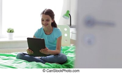 girl with tablet pc having video chat at home - people,...