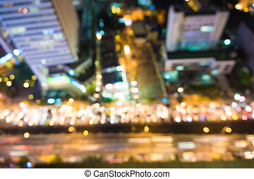 Blur view of Traffic at Bangkok city skyline for background
