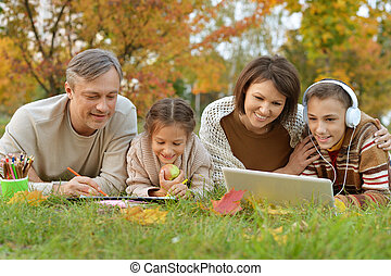 family spending time together outdoors in autumn