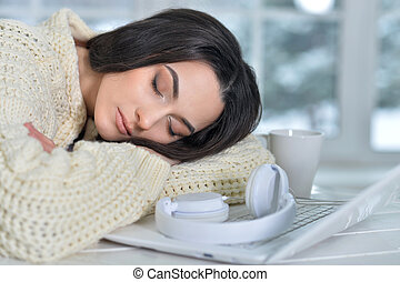 woman fell asleep - young woman fell asleep while using...