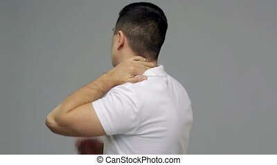 unhappy man suffering from neck pain - people, healthcare...