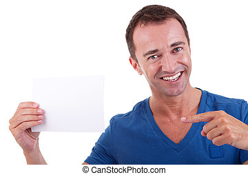 Portrait of a handsome man, with blank  card in hand, smiling, isolated on white background. Studio shot.