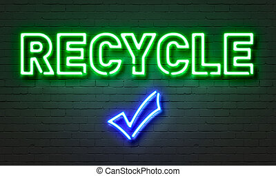 Recycle neon sign on brick wall background.