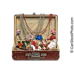 Christmas decorations in an old vintage suitcase